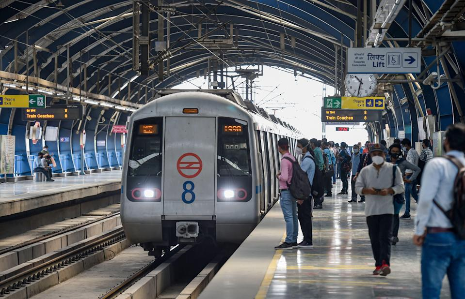Commuters wait to board a train at the Lakshmi Nagar Metro Station after resumption of the Delhi Metro services in a graded manner, in New Delhi on Monday, 7 June. The Delhi government has allowed shops and malls to open on an odd-even basis and private offices with 50 percent capacity as part of phased unlocking process.