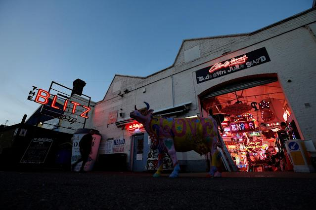 <p>Neon signs are seen at the entrance to God's Own Junkyard gallery and cafe in London, Britain at dusk, May 13, 2017. (Photo: Russell Boyce/Reuters) </p>