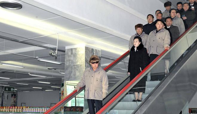 Kim Kyong-hui in 2011 stands behind then leader Kim Jong-il. Behind her are Kim Jong-un and Jang Song-thaek, who would be executed in 2013. File photo: AP