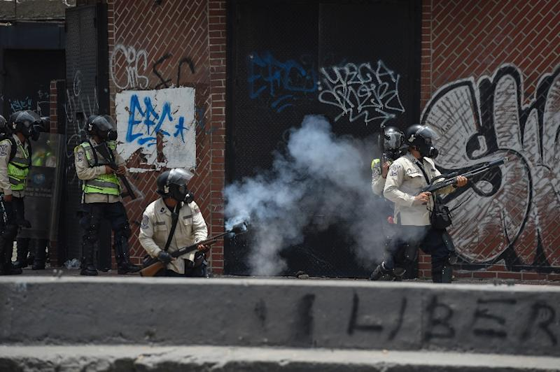 Riot police had deployed in force ahead of Wednesday's mass demonstrations in Caracas (AFP Photo/JUAN BARRETO                        )