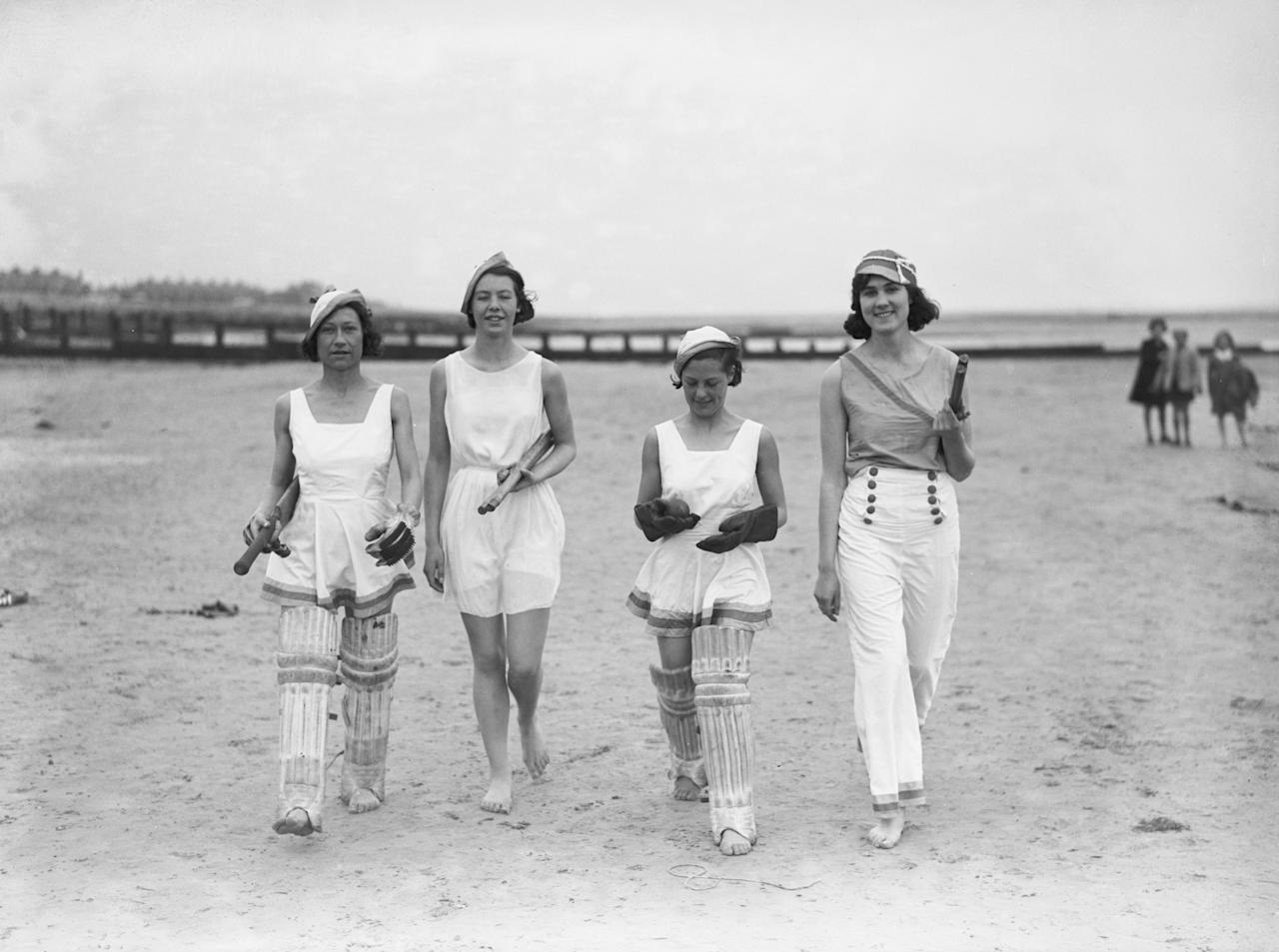 12th May 1934:  A group of women dressed for a game of cricket on the beach.  (Photo by Reg Speller/Fox Photos/Getty Images)