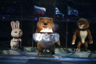 Performers play their part among Olympic mascots during the closing ceremony for the 2014 Sochi Winter Olympics February 23, 2014. REUTERS/Phil Noble (RUSSIA - Tags: OLYMPICS SPORT)