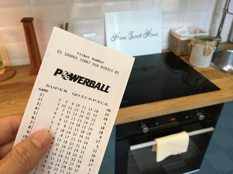 A person holds a Powerball ticket.
