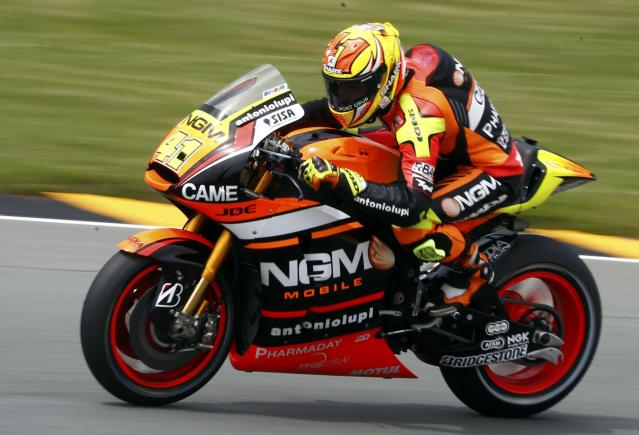 Forward Yamaha Moto GP rider Aleix Espargaro of Spain competes during the German Grand Prix at the Sachsenring circuit in the eastern German town of Hohenstein-Ernstthal July 13, 2014. REUTERS/Thomas Peter (GERMANY - Tags: SPORT MOTORSPORT)