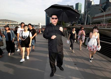 Howard, an Australian-Chinese impersonating North Korean leader Kim Jong Un, strolls down Jubilee Bridge in Singapore