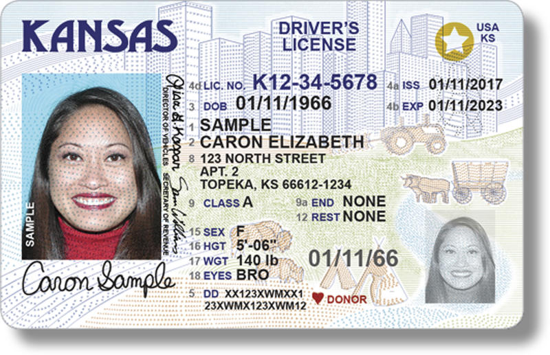 "This undated photo provided by the Kansas Department of Revenue shows Kansas' new driver's license design meant to comply with federal identification requirements for airport security purposes. The new licenses will contain either a gold circle with a white star cutout proving the holder is lawfully in the U.S. and that it is acceptable federal identification, or the words ""not for federal ID."" The revamped licenses come three years before they are required. (Kansas Department of Revenue via AP)"