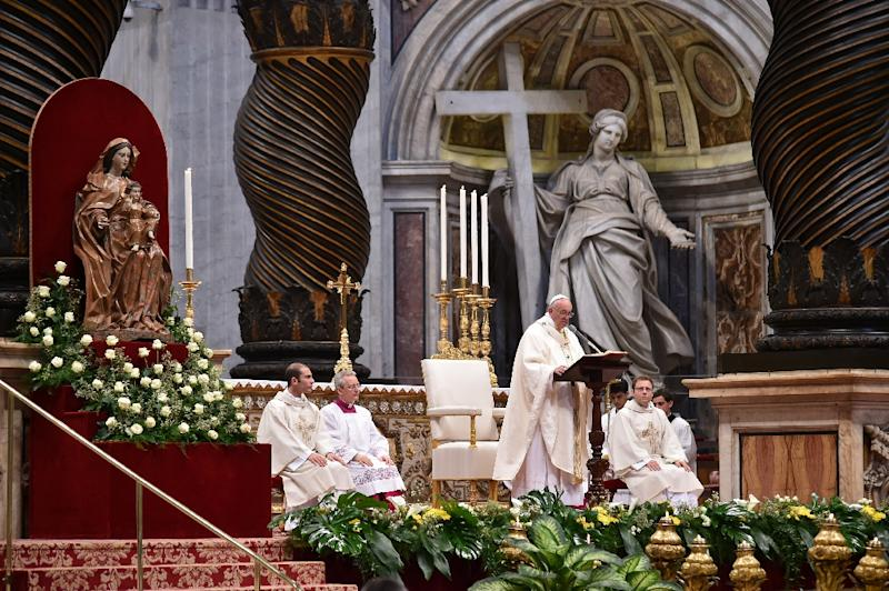 Pope Francis leads a mass with Priestly Ordinations of some deacons, on April 17, 2016 at St Peter's basilica in Vatican (AFP Photo/Alberto Pizzoli)