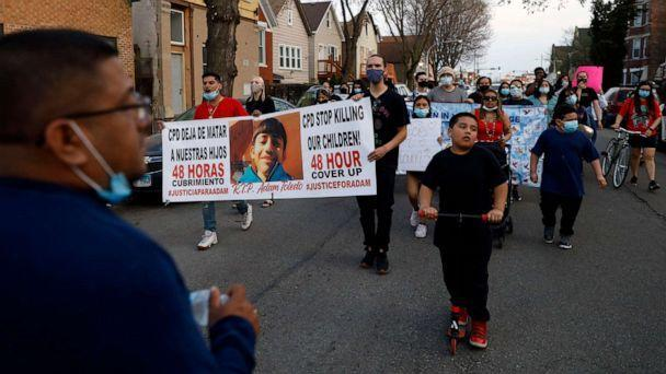 PHOTO: Members of Chicago's Little Village Community Council march on April 6, 2021, to protest against the death of 13-year-old Adam Toledo, who was shot by a Chicago Police officer at about 2 a.m. on March 29. (Shafkat Anowar/AP)