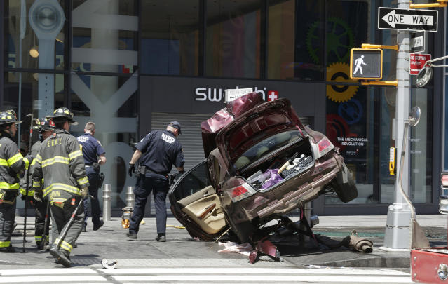 <p>Emergency workers at the scene after multiple people were injured when a vehicle struck numerous pedestrians in Times Square in New York City, New York, USA, 18 May 2017. Reports indicated that the vehicle was possibly speeding when it drove up onto the sidewalk striking the pedestrians. (Justin Lane/EPA) </p>