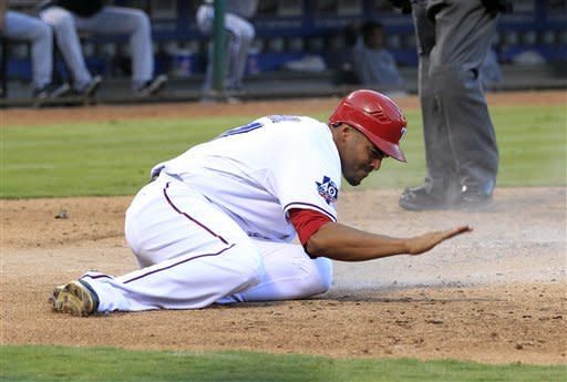 Texas Rangers right fielder Nelson Cruz (17) pounds the ground at home plate, after scoring in the fifth inning of a baseball game against the Chicago White Sox on Sunday, July 29, 2012, in Arlington, Texas. (AP Photo/John F. Rhodes)