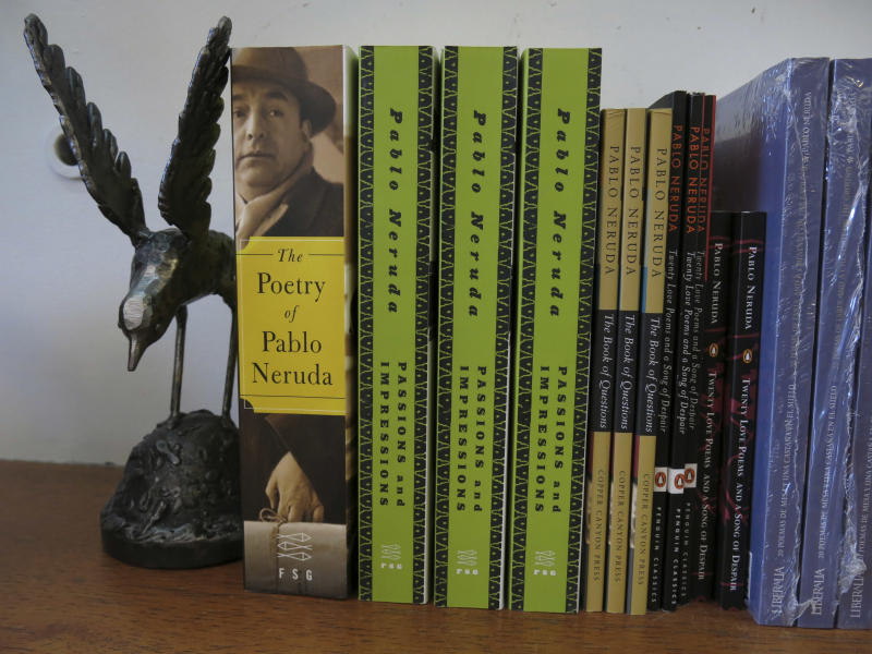 Works by Chile's Nobel-Prize winning poet Pablo Neruda are displayed for sale at a bookstore and museum located at his home in Santiago, Chile. The four-decade mystery of whether Neruda was poisoned was seemingly cleared up on Friday, when forensic test results showed no chemical agents in his bones. But his family and driver were not satisfied and said they'll request more proof. (AP photo/Luis Andres Henao)