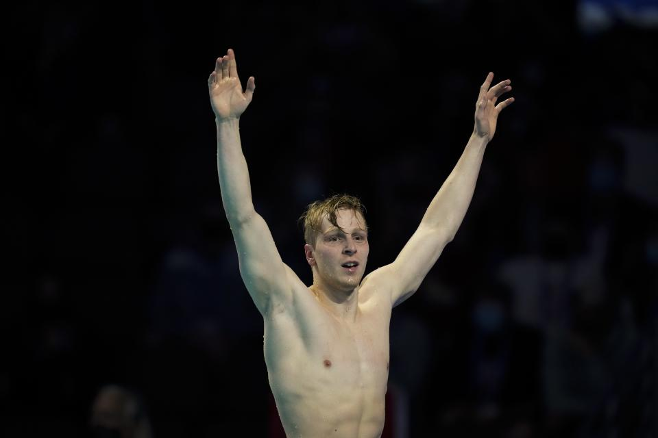 Zach Harting reacts after winning the men's 200 butterfly during wave 2 of the U.S. Olympic Swim Trials on Wednesday, June 16, 2021, in Omaha, Neb. (AP Photo/Charlie Neibergall)