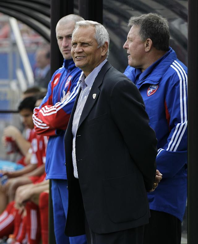 FC Dallas head coach Schellas Hyndman, front, stands by the bench before the start of their MLS soccer match against the New York Red Bulls Sunday, March 11, 2012, in Frisco, Texas. FC Dallas won 2-1. (AP Photo/Tony Gutierrez)