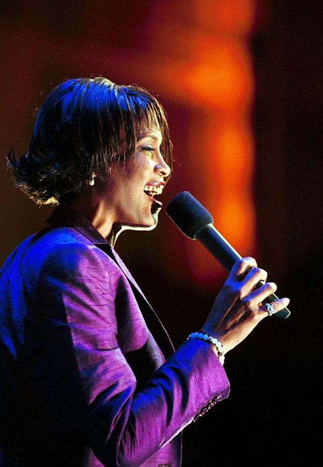 "Whitney Houston sings ""God Bless America"" at Radio City Music Hall in New York before the start of a light heavyweight bout between Roy Jones Jr and David Telesco Saturday, Jan. 15, 2000. Jones won by unanimous decision after 12-rounds. (AP Photo/Mark Lennihan)"