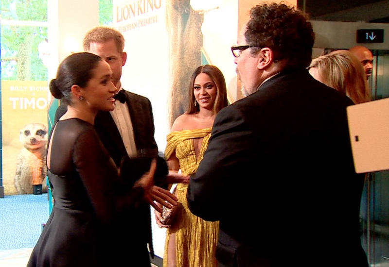Meghan and Harry (right) Beyonce (centre) and Jon Favreau at Disney premiere in July 2019