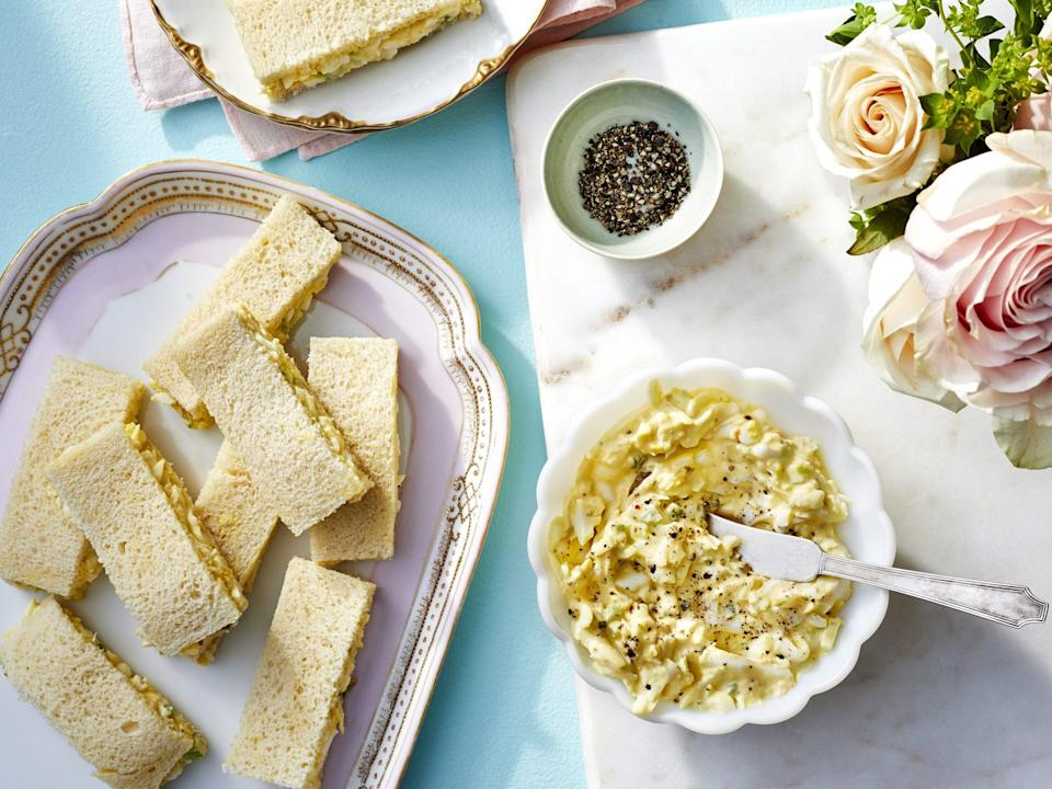 """<p><strong>Recipe: <a href=""""https://www.southernliving.com/recipes/egg-salad-sandwiches"""" rel=""""nofollow noopener"""" target=""""_blank"""" data-ylk=""""slk:Egg Salad Sandwiches"""" class=""""link rapid-noclick-resp"""">Egg Salad Sandwiches</a></strong></p> <p>Finger sandwiches are an easy, no-fuss dish to serve for any occasion. Plus, the egg salad can be prepared a day in advance of serving. </p>"""