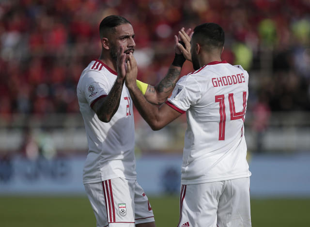 Iran's Ashkan Dejagah, left, and Saman Ghoddos celebrate their team's first goal during the AFC Asian Cup group D soccer match between Iran and Vietnam at Al Nahyan Stadium in Abu Dhabi, United Arab Emirates, Saturday, Jan. 12, 2019. (AP Photo/Nariman El-Mofty)