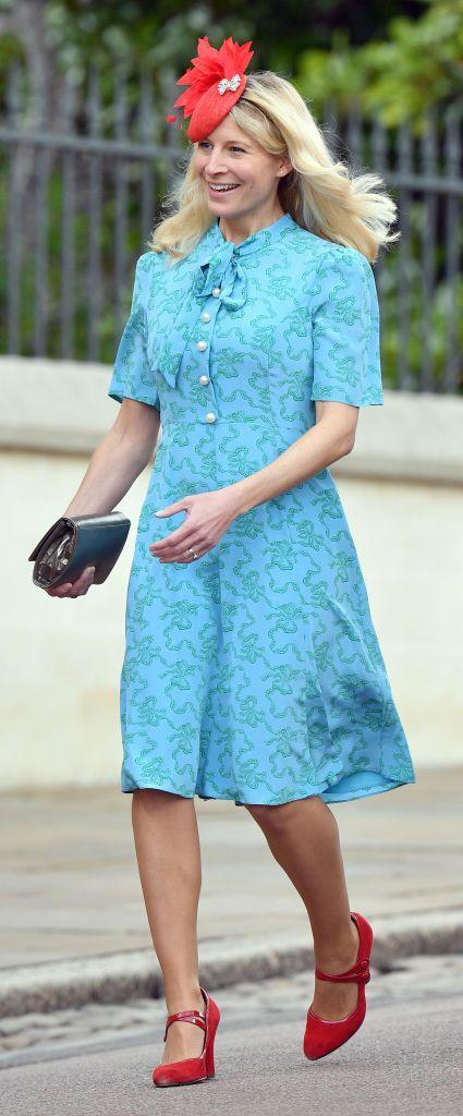 <p>Lady Rose Gilman offered a masterclass in color coordination at the wedding of Lady Gabriella Windsor and Thomas Kingston, when she paired a bright red fascinator with a sweet blue dress.</p>