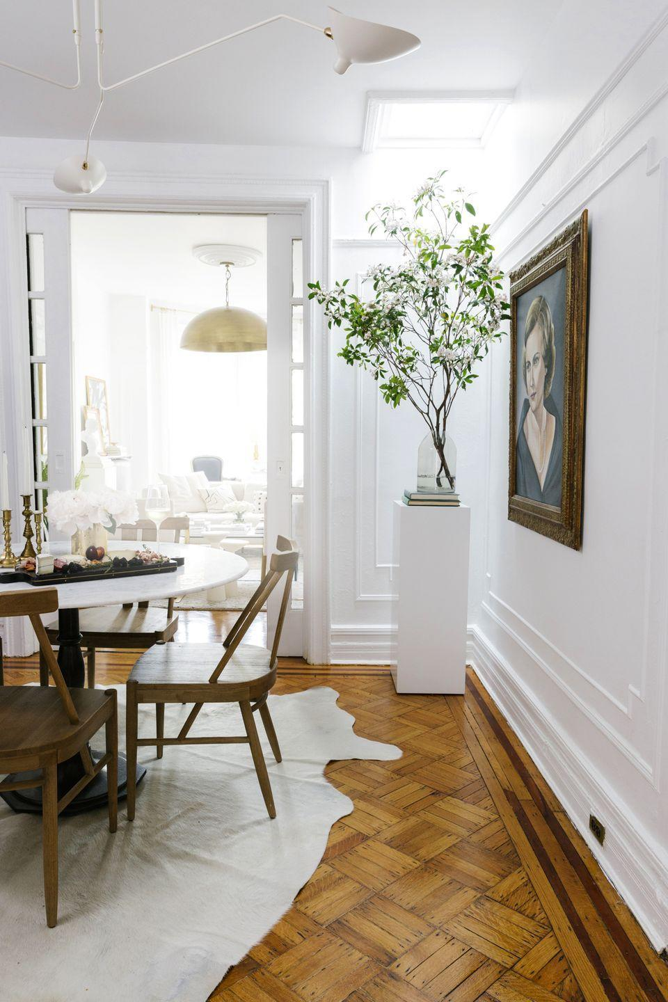 <p>Paint a wooden pedestal in any solid color of your choice, and then use it to play up different heights in your space with stacked books and fresh greens. </p>