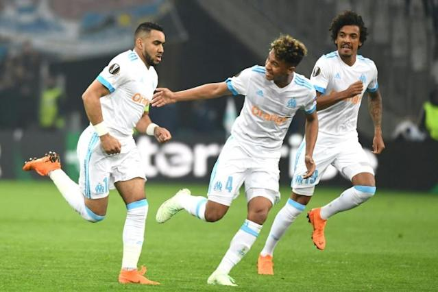 Dimitri Payet (L) celebrates with his Marseille teammates during the French side's dramatic win against RB Leipzig