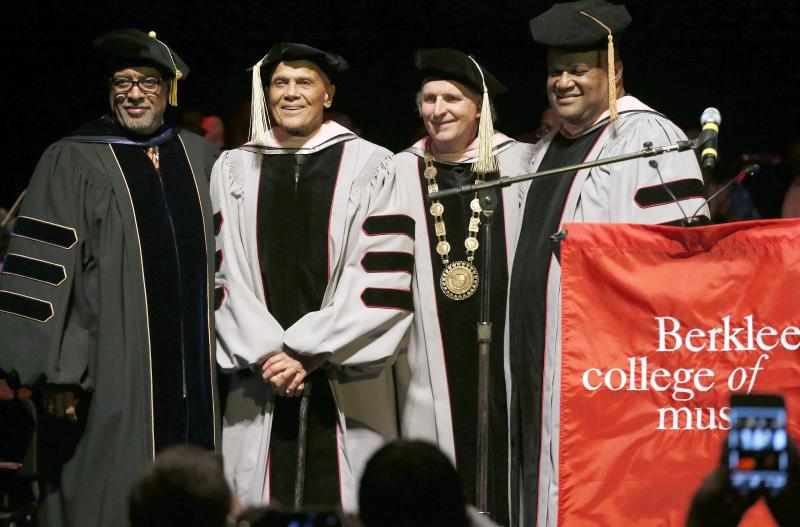 Harry Belafonte, center left, stands with Berklee College of Music President Roger H. Brown, center right, after receiving an honorary doctor of music degree at the Berklee Performance Center in Boston, Thursday, March 6, 2014. (AP Photo/Michael Dwyer)