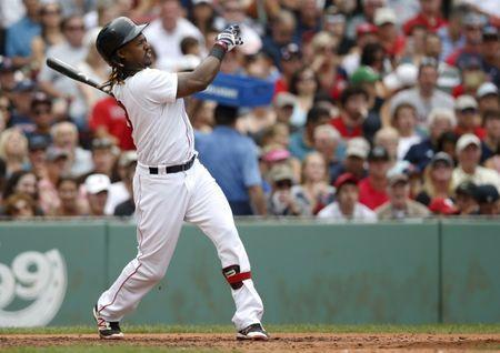 Aug 31, 2016; Boston, MA, USA; Boston Red Sox first baseman Hanley Ramirez (13) hits a grand slam against the Tampa Bay Rays during the fifth inning at Fenway Park. Mandatory Credit: Greg M. Cooper-USA TODAY Sports / Reuters Picture Supplied by Action Images