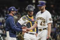 Milwaukee Brewers manager Craig Counsell take starting pitcher Adrian Houser out of the game during the fifth inning of a baseball game against the Pittsburgh Pirates Friday, April 16, 2021, in Milwaukee. (AP Photo/Morry Gash)