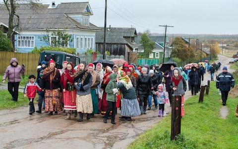 Locals participate in a folk festival in Nyonoksa, where activists have called for additional radiation testing - Credit: Sergei Yakovlev/AP