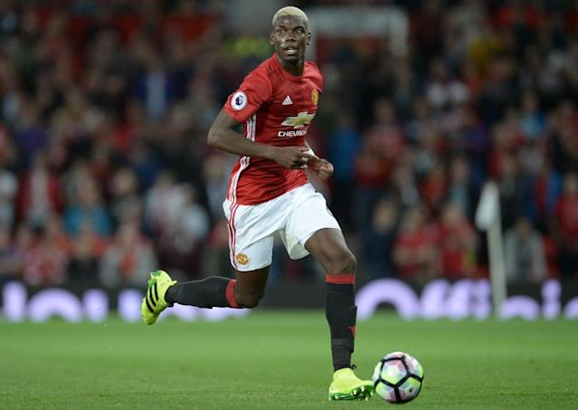 Manchester United set a new world record with the 89 million pound purchase this month of French midfielder Paul Pogba (AFP Photo/Oli Scarff)