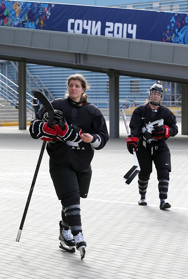 SOCHI, RUSSIA - FEBRUARY 05: Laura Fortino #8 (L) and Catherine Ward #18 of Canada walk to the arena for a women's ice hockey practice session ahead of the Sochi 2014 Winter Olympics at the Olympic Park on February 5, 2014 in Sochi, Russia. (Photo by Bruce Bennett/Getty Images)