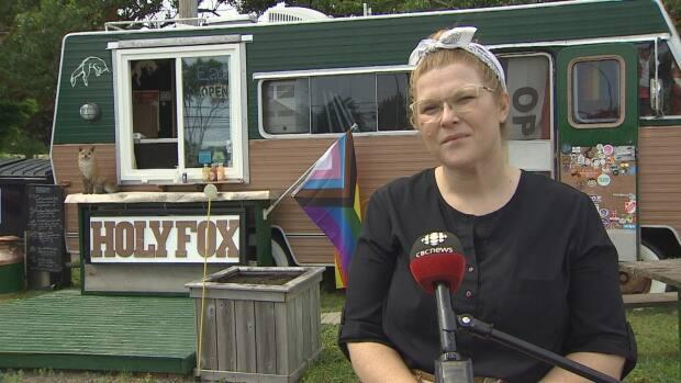 Paige Hart, co-owner of Holy Fox food truck, says it seems the flag was deliberately cut with scissors or a knife. (Kirk Pennell/CBC - image credit)