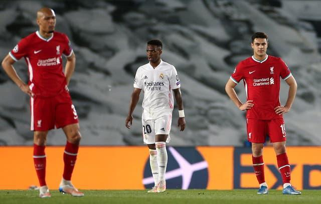 Liverpool's Fabinho (left) and Ozan Kabak appear dejected after conceding against Real Madrid