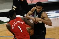 New Orleans Pelicans' Zion Williamson steals the ball from Milwaukee Bucks' Giannis Antetokounmpo during the second half of an NBA basketball game Thursday, Feb. 25, 2021, in Milwaukee. (AP Photo/Morry Gash)