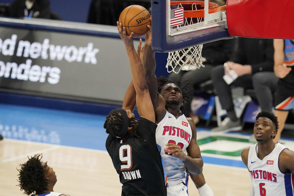Detroit Pistons center Isaiah Stewart, right, blocks a shot by Oklahoma City Thunder center Moses Brown (9) in the first half of an NBA basketball game Monday, April 5, 2021, in Oklahoma City. (AP Photo/Sue Ogrocki)