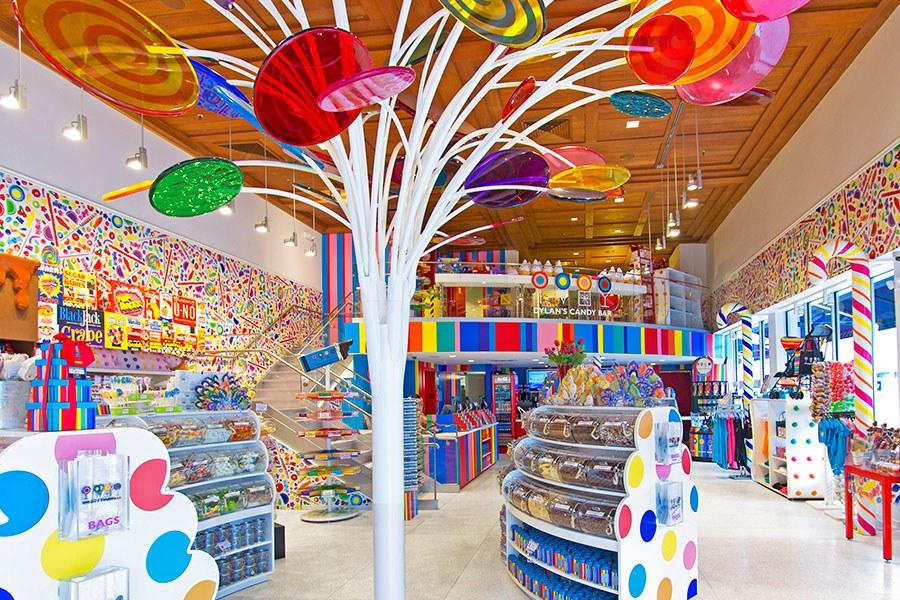 """<em>801 Lincoln Road, Miami</em><br> <em><a rel=""""nofollow"""" href=""""https://www.dylanscandybar.com/"""">dylanscandybar.com</a></em><br> Candy mogul Dylan Lauren—daughter of fashion designer Ralph Lauren—brought her popular treat emporium south in 2013. A lollipop tree stands in the center of the main floor, candy cane columns surround the perimeter, and cases are adorned with oversize candy buttons. Lauren collaborated with Gensler on the design for the space in the landmarked building and kept the original wood ceilings, which she thought looked like chocolate bars."""