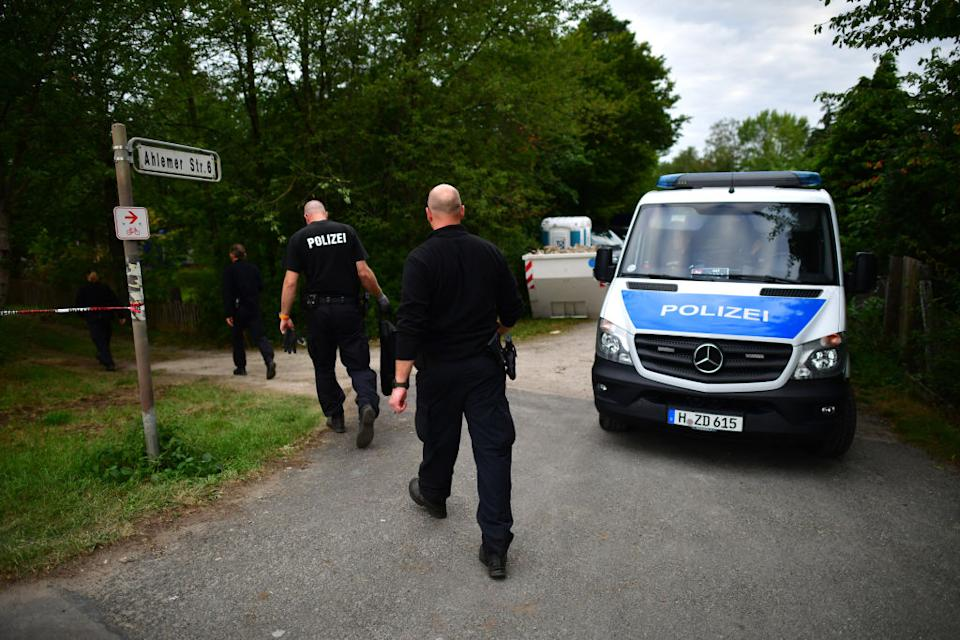Police arrive at an allotment as officers continue to search the area in relation to the disappearance of Madeleine McCann in Hanover, Germany.