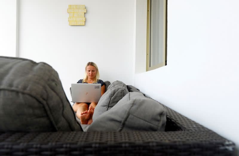 Olga Paul, a 34-year-old from Germany, works remotely from Las Palmas De Gran Canaria