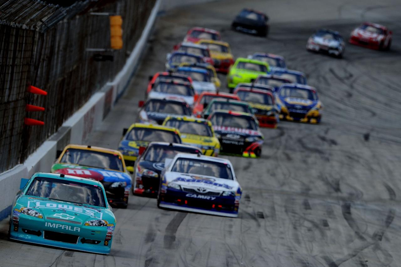 DOVER, DE - JUNE 03:  Jimmie Johnson, driver of the #48 Lowe's Madagascar Chevrolet, leads a group of cars during the NASCAR Sprint Cup Series FedEx 400 benefiting Autism Speaks at Dover International Speedway on June 3, 2012 in Dover, Delaware.  (Photo by Patrick Smith/Getty Images for NASCAR)