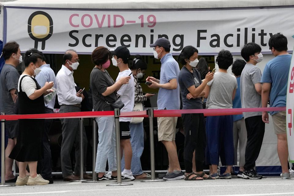 People queue for coronavirus testing at a Public Health Center in Seoul, South Korea on Friday, 9 July, as the country reports its worst wave of infections since the start of the pandemic (AP)