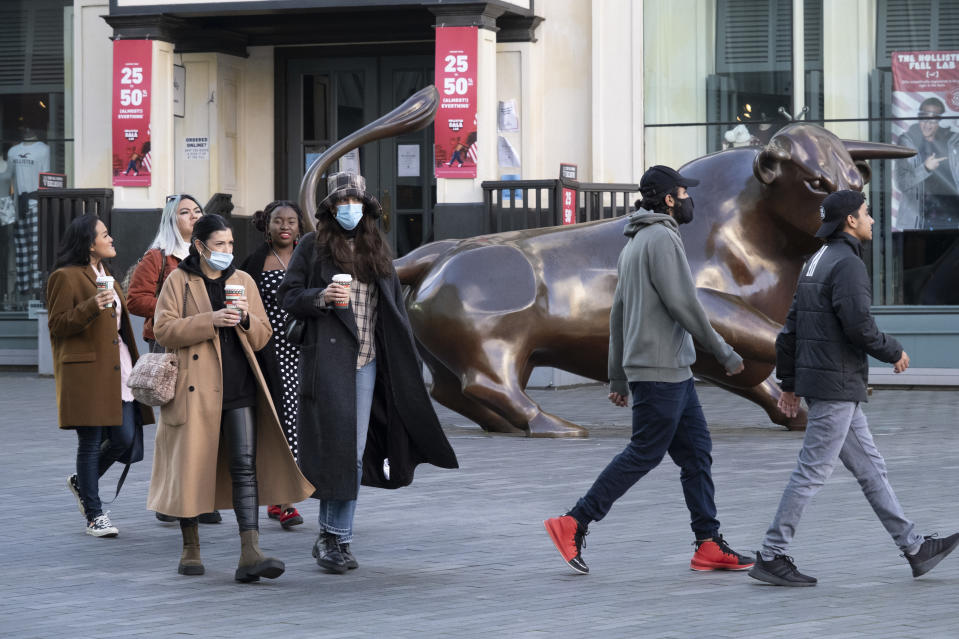 People wearing face masks in the Bull Ring shopping area in the City Centre on the day it was announced that Birmingham would be placed in tier three for very high alert level of the new Coronavirus tier system following the end of the second national lockdown on 26th November 2020 in Birmingham, United Kingdom. The national lockdown and following tier 3 status is a huge blow to the economy and for individual businesses in Britain's second city, who were already struggling after eight months of Covid-19 restrictions. In tier 3 people can only meet other households in outdoor public spaces like parks, where the rule of six applies. (photo by Mike Kemp/In Pictures via Getty Images)