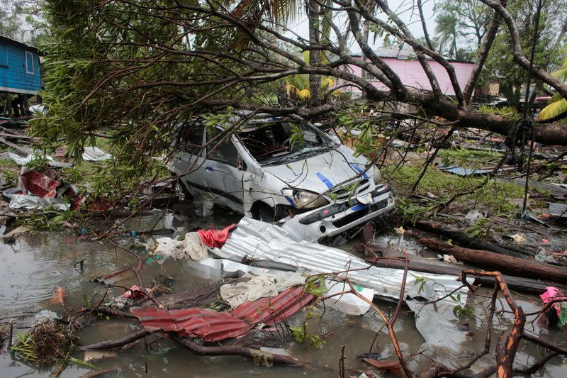 A car damaged by a tree is pictured after the passing of Hurricane Iota, in Puerto Cabezas