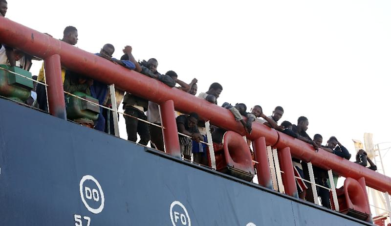 Illegal migrants stand on the deck of a Libyan oil tanker that rescued them off the coast of the capital Tripoli on September 18, 2015 (AFP Photo/Madmud Turkia)