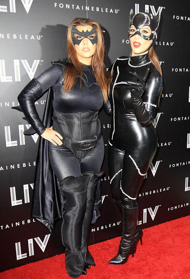 Kim and Kourtney Kardashian attend Kim Kardashian's Halloween Birthday Bash at LIV Nightclub/Fontainebleau Miami Beach. The sisters arrived dressed in costume as Batwoman and Catwoman.