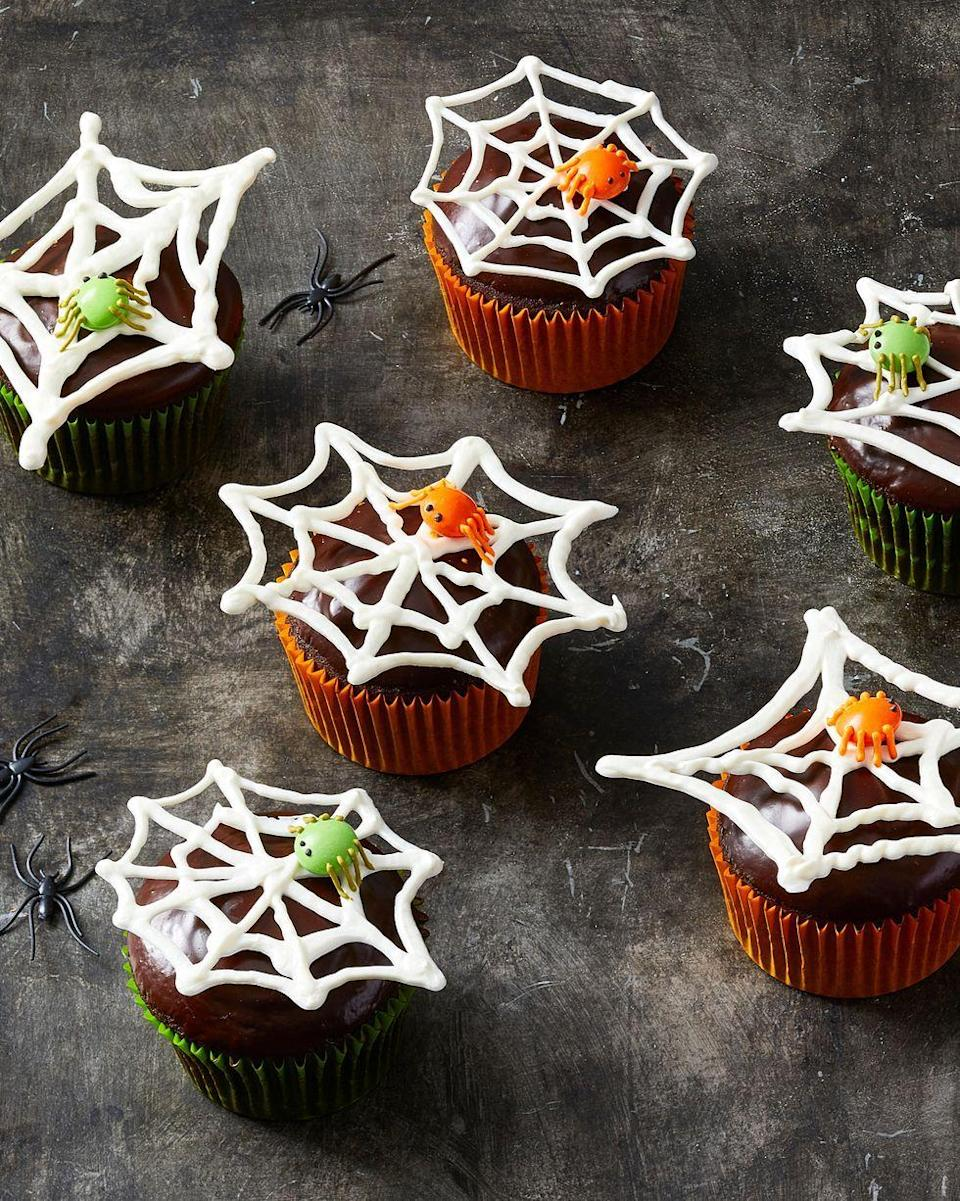 """<p>These creepy crawly cupcakes will stand out on the desserts table.</p><p><em><a href=""""https://www.goodhousekeeping.com/food-recipes/party-ideas/a28593454/spiderweb-cupcakes-recipe/"""" rel=""""nofollow noopener"""" target=""""_blank"""" data-ylk=""""slk:Get the recipe for Spiderweb Cupcakes »"""" class=""""link rapid-noclick-resp""""> Get the recipe for Spiderweb Cupcakes »</a></em> </p><p><strong>RELATED: </strong><a href=""""https://www.goodhousekeeping.com/holidays/halloween-ideas/g33437890/halloween-table-decorations-centerpieces/"""" rel=""""nofollow noopener"""" target=""""_blank"""" data-ylk=""""slk:40 Chic and Spooky Halloween Table Decorations for DIY Lovers"""" class=""""link rapid-noclick-resp"""">40 Chic and Spooky Halloween Table Decorations for DIY Lovers</a></p>"""