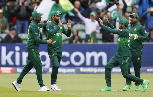 Pakistan's Mohammad Hafeez, second left celebrates after taking a catch to dismiss Australia's captain Aaron Finch off the bowling of Pakistan's Mohammad Amir during the Cricket World Cup match between Australia and Pakistan at the County Ground in Taunton, south west England, Wednesday, June 12, 2019. (AP Photo/Alastair Grant)