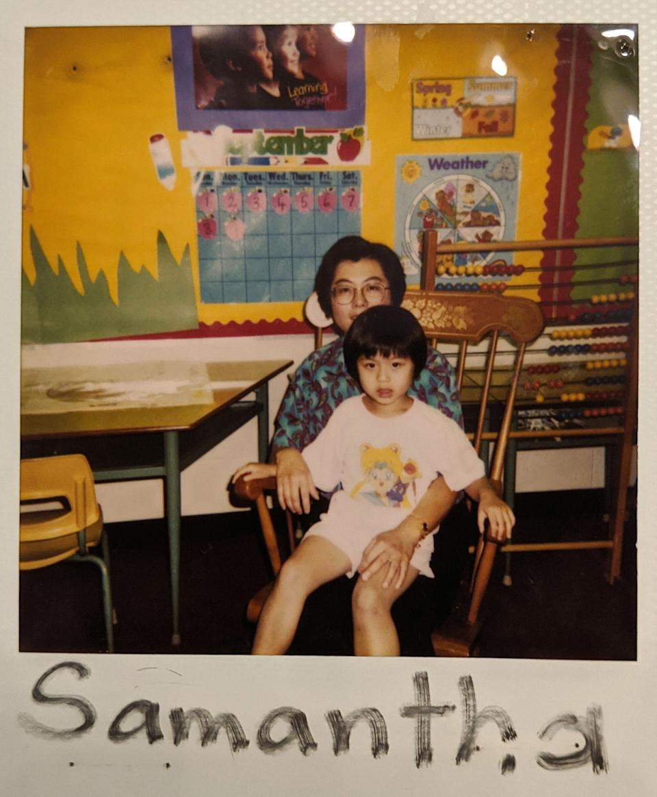 A family photo of the writer as a child, pictured seated on her immigrant mother's lap. (Photo: Samantha Lui)