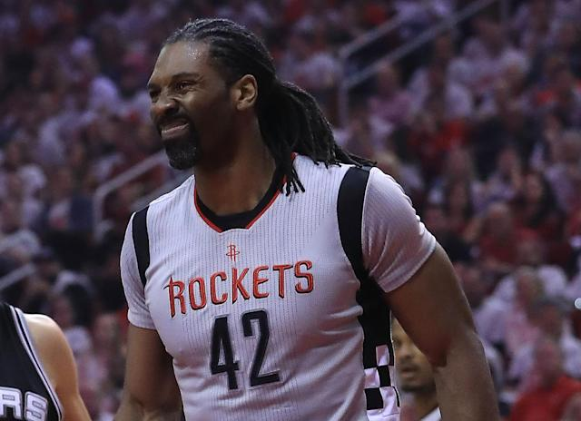Nene knew something had gone wrong early in Game 4. (Getty Images)