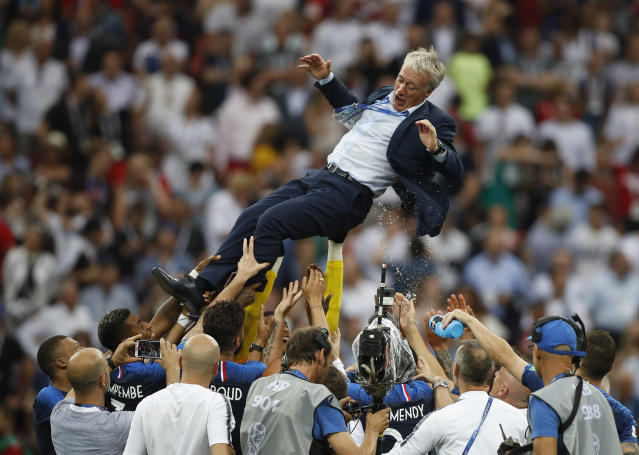France head coach Didier Deschamps is thrown into the air by his players as they celibate after defeating Croatian in the match between France and Croatia at the 2018 soccer World Cup in the Luzhniki Stadium in Moscow, Russia, Sunday, July 15, 2018. France won the game 4-2. (AP Photo/Francisco Seco)