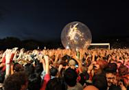 Wayne Michael Coyne, the lead singer and guitarist of American band The Flaming Lips, performs inside a plastic ball during the Optimus Primavera Sound music festival in Porto, Portugal, Friday, June 8 2012. (AP Photo/Paulo Duarte) EDITORIAL USE ONLY