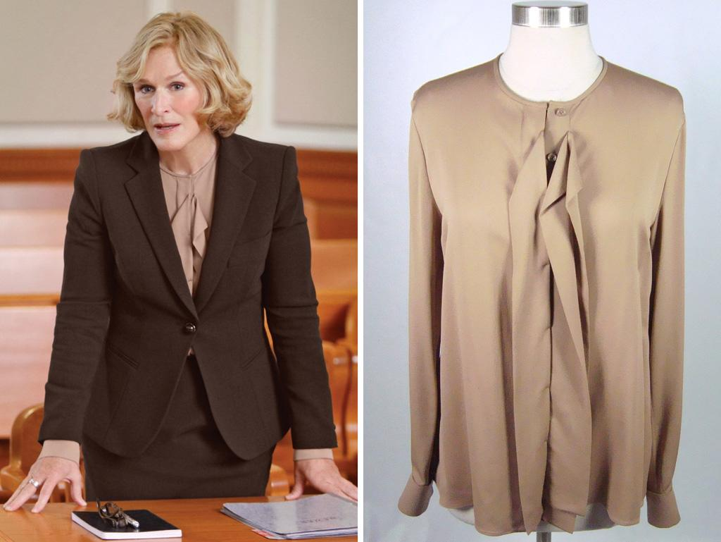 "Loro Piana brown panel accent silk blouse. Chic, flowing vertical panel at front creates an elegantly fluid style. Unlined. Opaque. No stretch. Vented at back. Covered button up panel at front. Made in Italy. From Glenn Close's ""Damages"" wardrobe. Shoulder to shoulder measures about 18 inches across back. Outside arms measure about 26 inches long. Underarm to underarm measures about 20 inches across front. Waist measures about 21 inches across front. Hips measure about 23 inches across front. Measures about 26 inches from top to bottom.